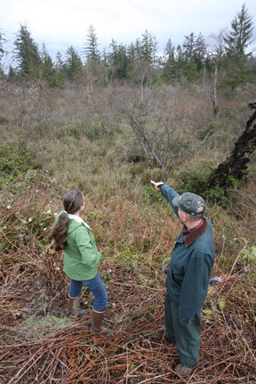NCLC Executive Director Katie Voelke and landowner Paul McCracken discuss the acquisition of Coal Creek Swamp near Nehalem